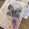Přáníčko ve žluto fialkových s motýlími křídly a nápisem All we need is love